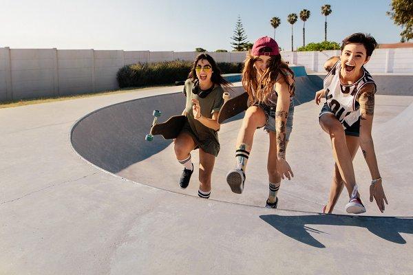 Laughing women climbing