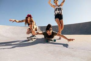 Women riding skateboards