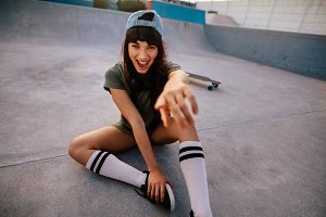 Laughing female skateboarder