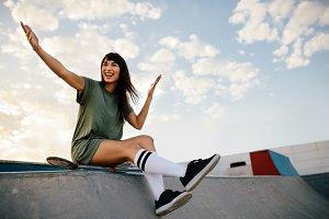 Woman skateboarder enjoying