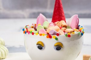 Unicorn cocoa with colorful sprinkles, marshmallow and cookies