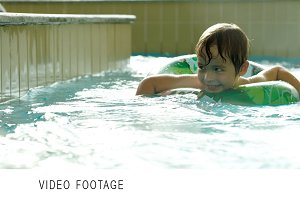 Boy with rubber ring swimming