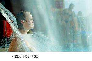 Woman refreshing under water shower