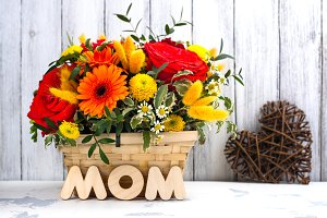 Basket with beautiful bright flowers. Mothers day greeting card
