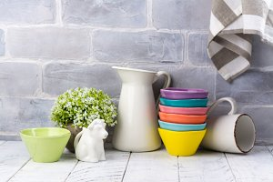 Ceramic and enamel crokery tableware agains brick wall