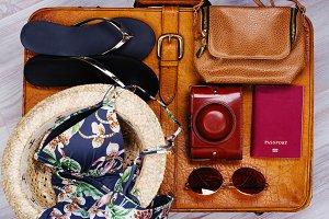 Leather suitcase with woman travel accessories