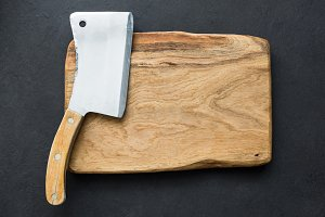 Old meat cleaver and chopping board