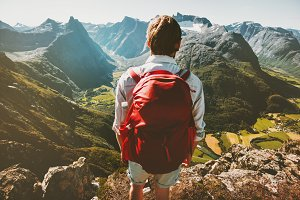 Man with red backpack in mountains