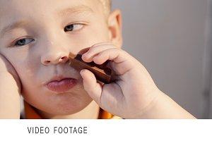Close-up shot of a little boy eating