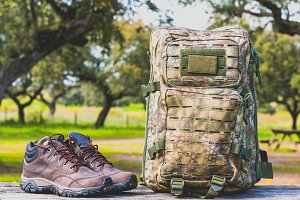 hiking boots and camouflage backpack