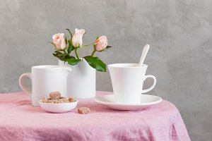 White cup and roses
