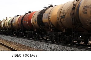 Freight train with tank cars passing