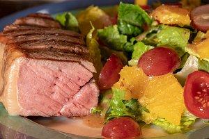 Thick New York Strip steak cooked medium rare