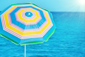 Colorful umbrella on tropical beach