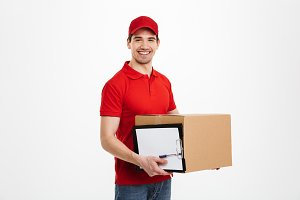 Happy young delivery man with parcel post box