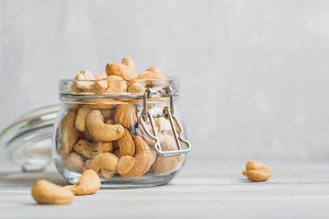 Cashew nuts in an open glass jar