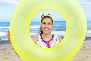 Woman with a donut-shaped float