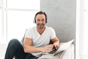 Joyful mature man listening to music