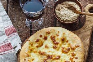Megrelian Georgian khachapuri or cheese flatbread. Homemade baking. Top view