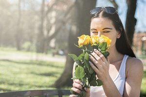 Woman smelling the flowers
