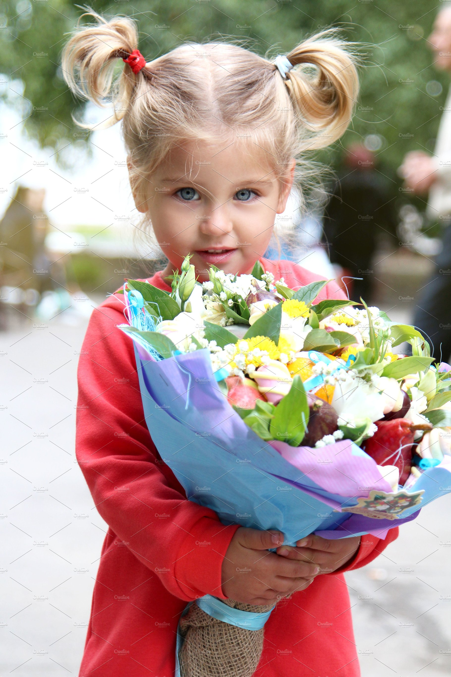 Girl Is Holding A Bouquet Of Flowers People Images Creative Market