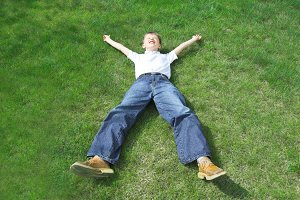 Young boy lying on the grass