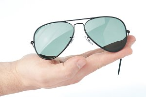 Sunglasses lay on hand palm