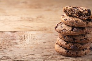 Cookies with chocolate chips on a wooden table. with copy space