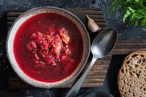 Beet soup Borscht in rustic bowl