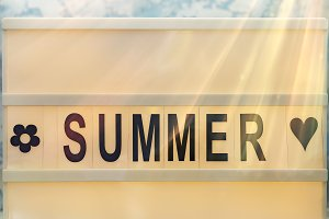 Summer letter on the led board on table. Concept of summer tourism, travel and vacation