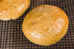 Loaves of rosemary bread cooling