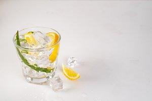 fresh aloe vera leaves and aloe vera juice in glass on white background