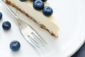 Piece of cheesecake with blueberry