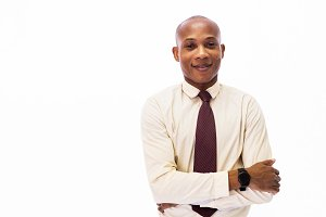 Attractive happy African American smiling professional businessman executive isolated over white background