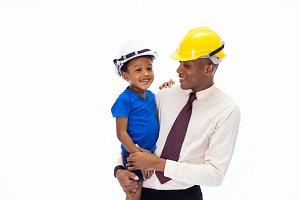 African American happy family of father and son wearing an engineering helmet together, like father like son or well education concept