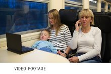 Son with mother watching video
