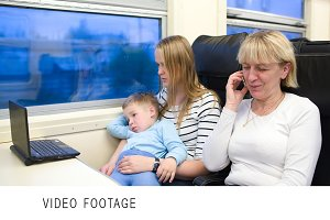 Passengers in the train watching vid