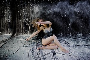 woman dancing with flour