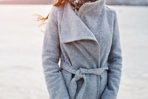 Young model girl in gray coat