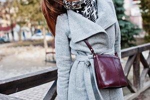 Young model girl in gray coat