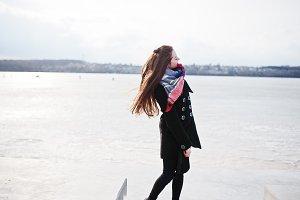 Casual young girl at black coat