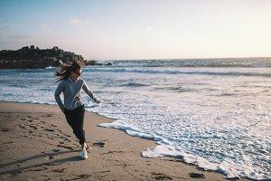 Girl running near sea