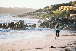 Girl walking near stormy sea