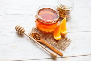 A jar of honey and orange