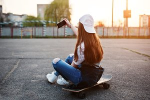 teenage urban girl with skateboard