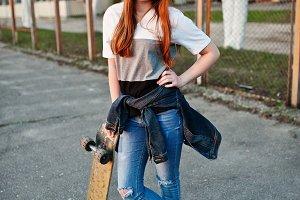 teenage urban girl with skateboard