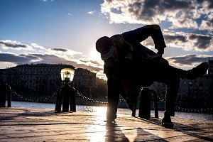 young street dancer moving in the city action during sunset