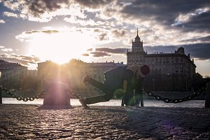 young man in jacket hip hop street dancing in the city near the river during sunset
