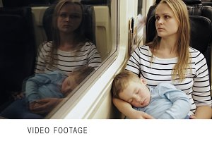 Tired woman in train with sleeping