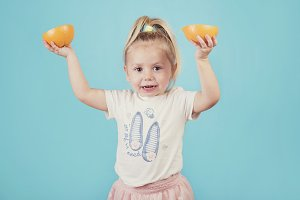 smiling baby with an orange